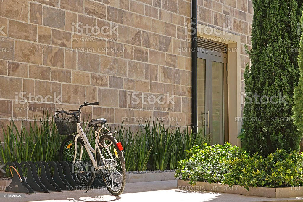 Bicycle parked on a pedestrian street stock photo