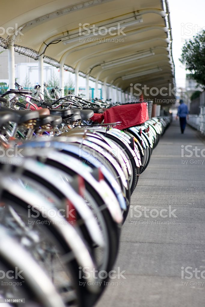 Bicycle parking lot, with attendant royalty-free stock photo