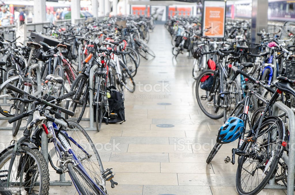 Bicycle parking/rack full of bikes in train station of London stock photo