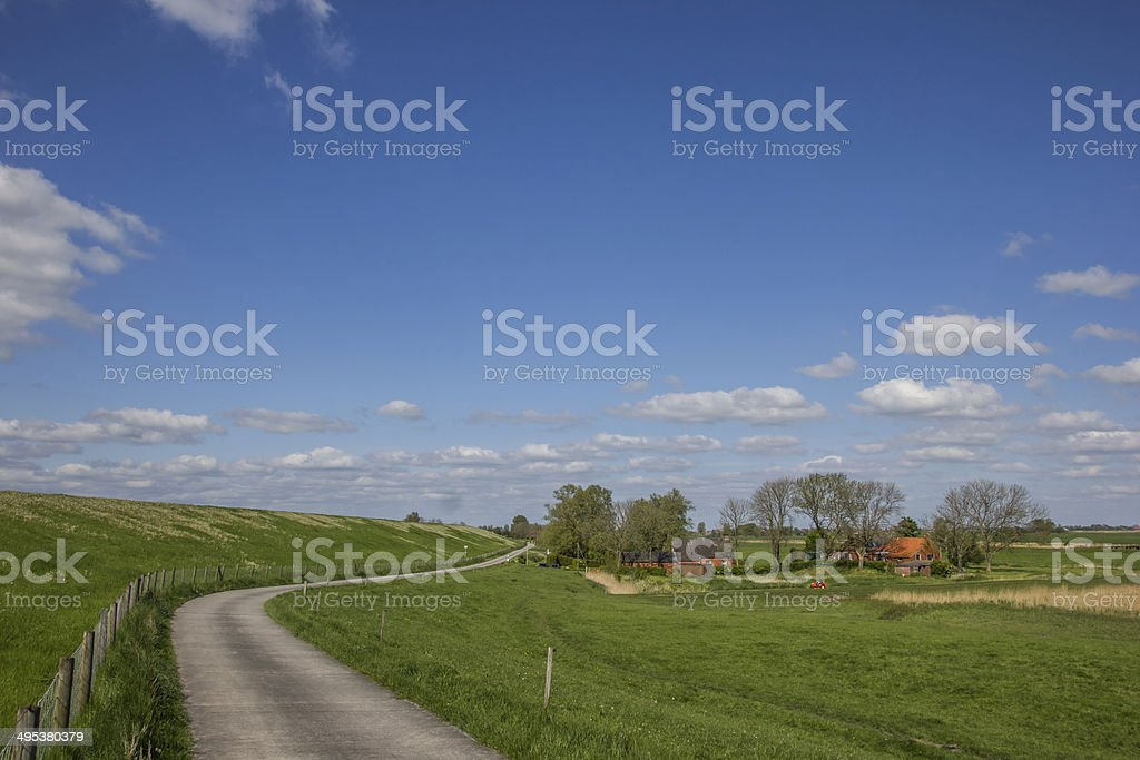 Bicycle path along the dollard route in Ostfriesland stock photo