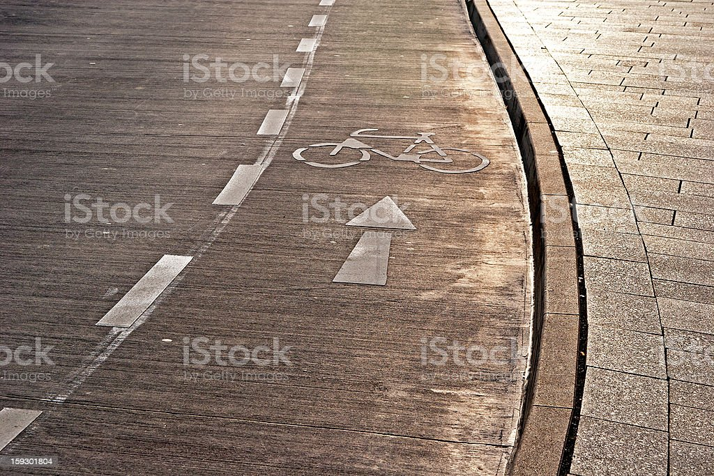 Bicycle path and sidewalk in the sunlight royalty-free stock photo