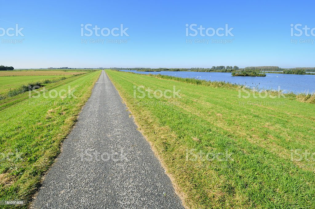 Bicycle path on a dyke royalty-free stock photo