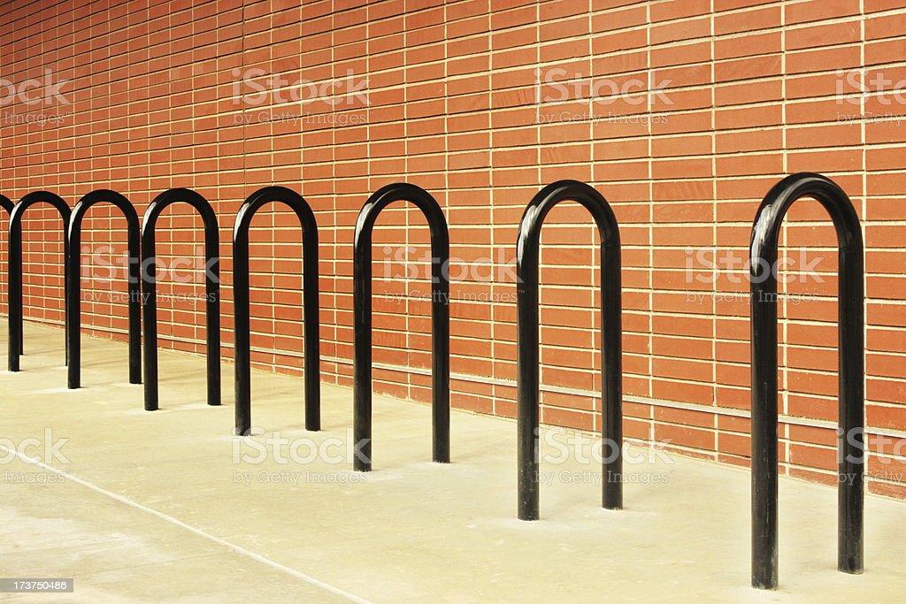 Bicycle Rack Brick Facade Concrete Sidewalk royalty-free stock photo