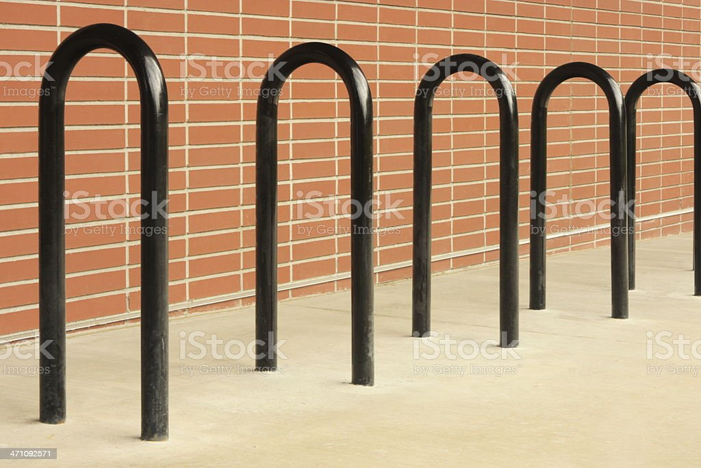 Bicycle Rack Brick Wall Sidewalk royalty-free stock photo