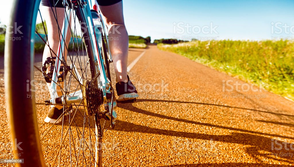 Bicycle ready to move forward on long country road stock photo