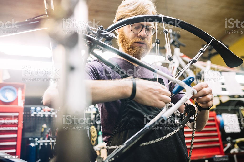 Bicycle Repair Shop and Man Working stock photo