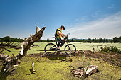 Bicycle rider in the swamp