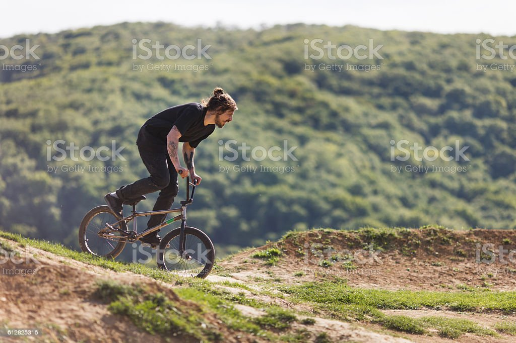 bicycle rider practicing on dirt road during a day. stock photo