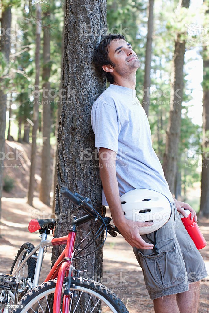 bicycle rider relaxing in forest royalty-free stock photo