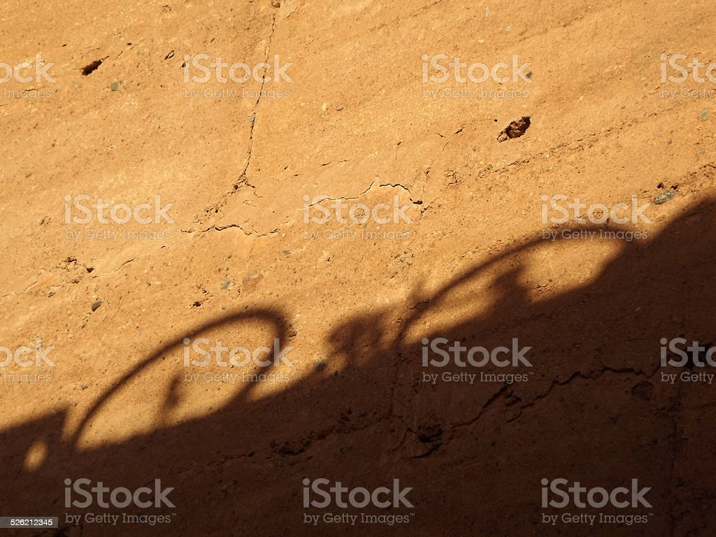 Bicycle Shadow on a Wall of the El Badi Palace stock photo