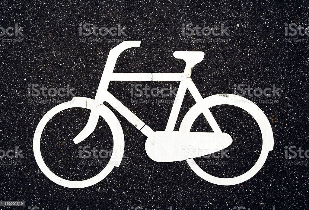Bicycle sign on asphalt royalty-free stock photo