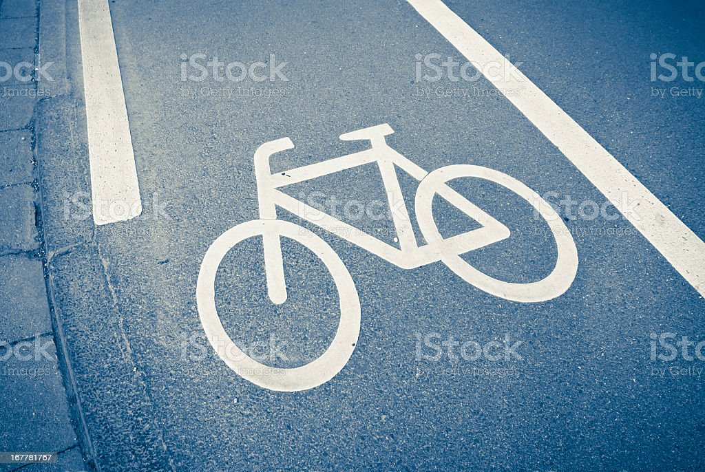 Bicycle Sign On The Asphalt In A Dutch Street royalty-free stock photo
