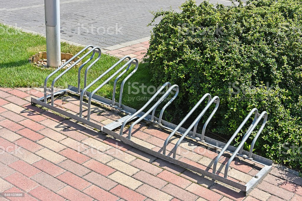 Bicycle storage at the parking lot stock photo
