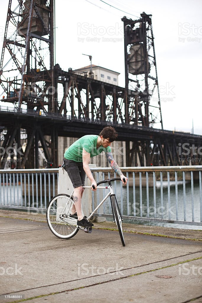 Bicycle Stunt Man Balancing Without Moving Outdoors stock photo