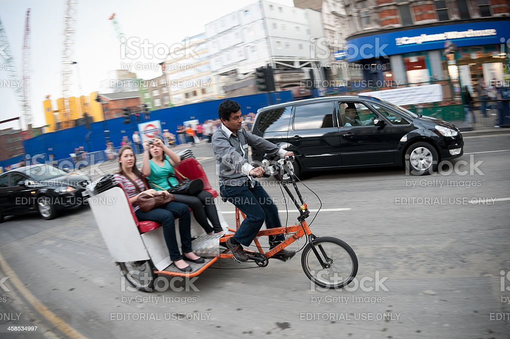 Bicycle taxi cab in central London, motion blur stock photo
