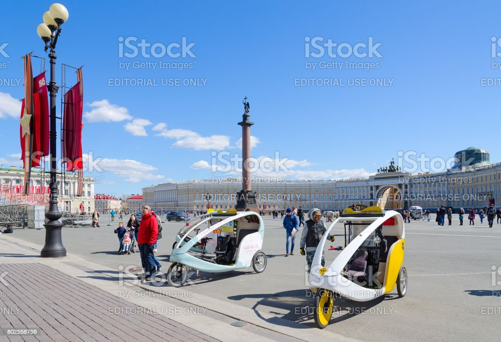 Bicycle taxi on Palace Square, St. Petersburg, Russia stock photo