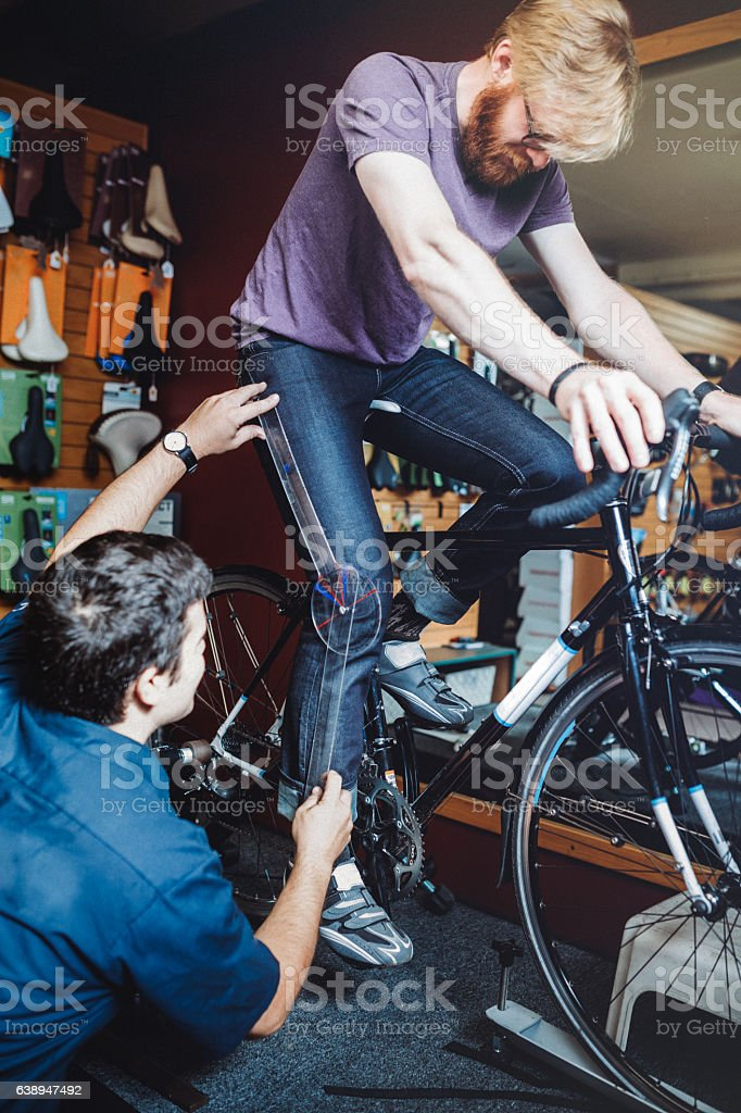 Bicycle Technician Fitting Bike stock photo