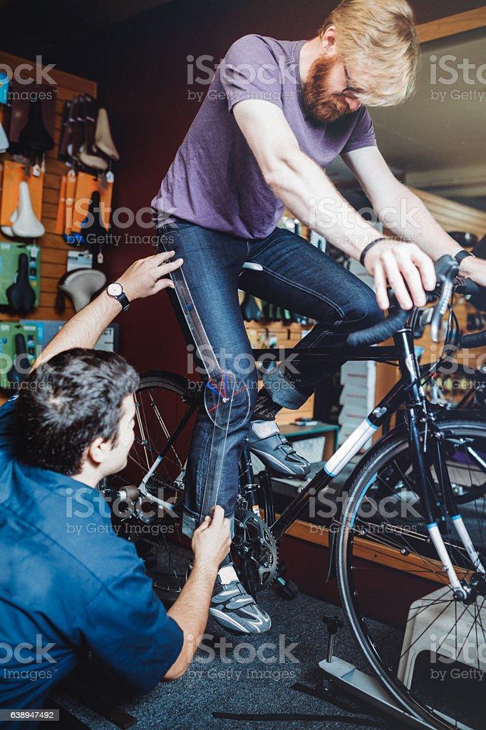 Bicycle Technician Fitting Bike stock photo