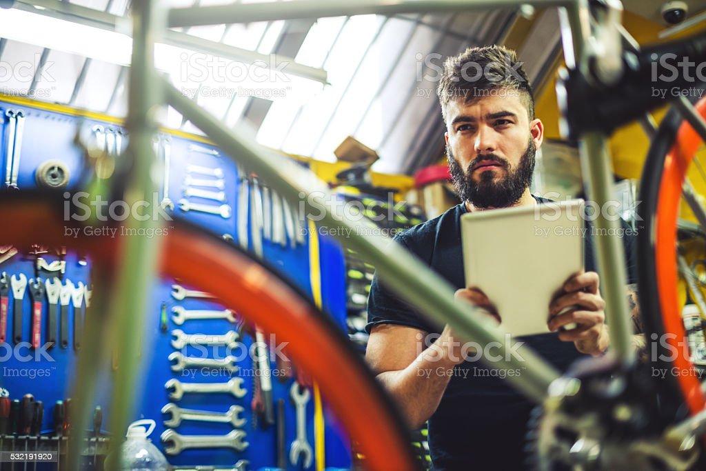 Bicycle technician stock photo