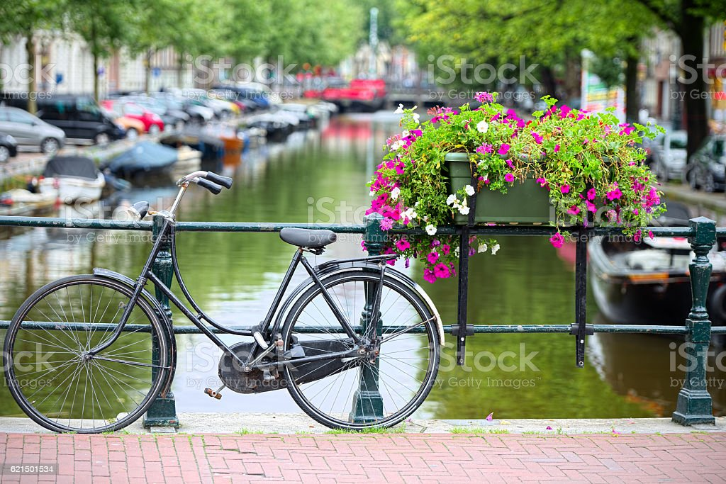 Bicycle tied to a bridge in Amsterdam stock photo