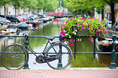 Bicycle tied to a bridge in Amsterdam
