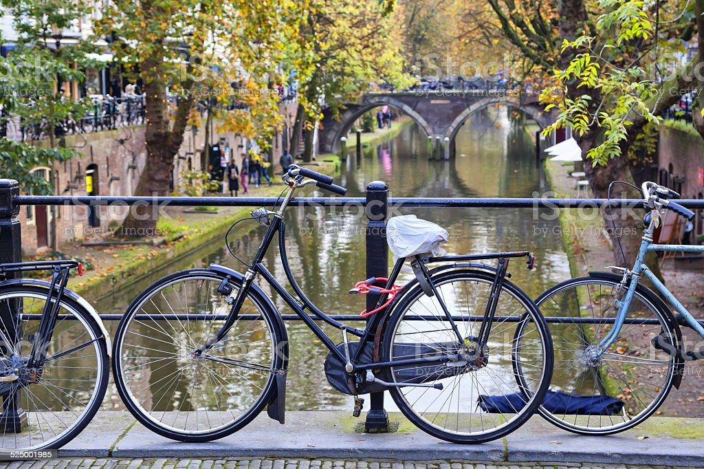 Bicycle tied to the fence of the bridge  in Utrecht stock photo