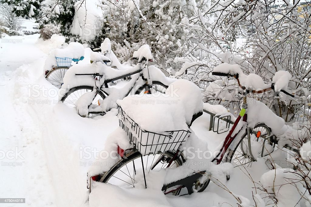 Bicycle under snowdrift stock photo
