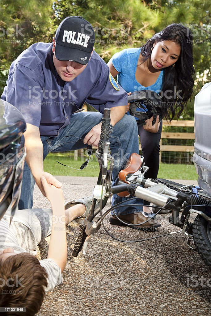Bicycle vehicle accident with child and on ground between cars royalty-free stock photo