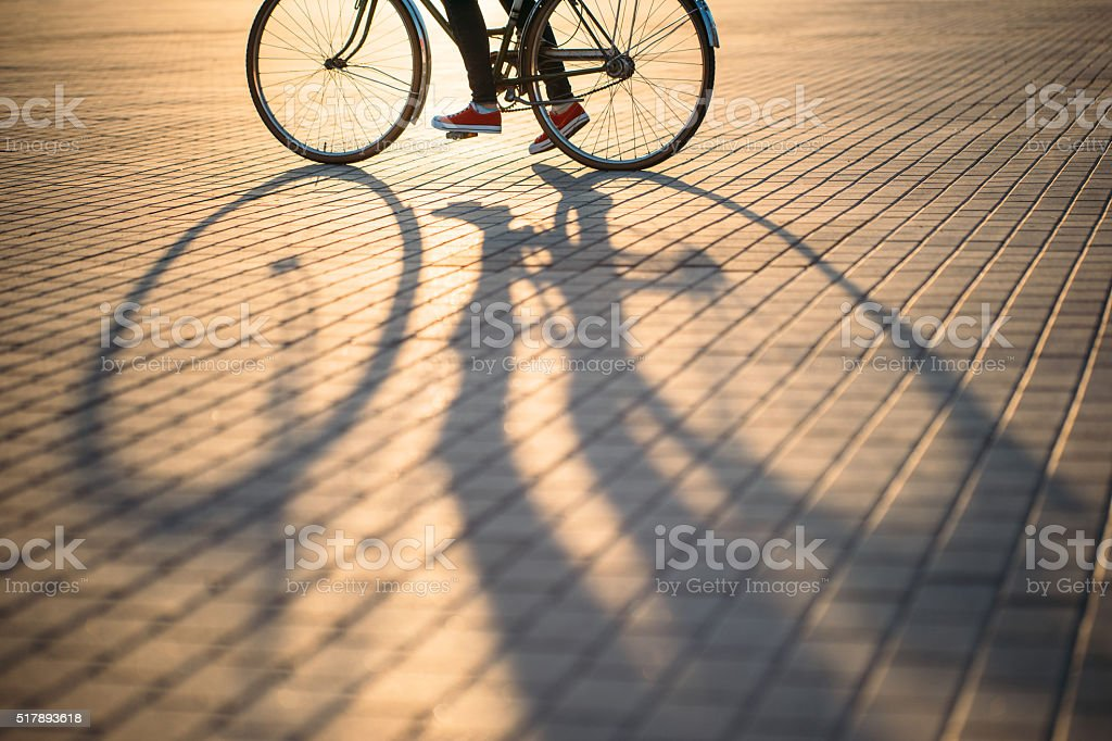 Bicycle wheel and shadow stock photo