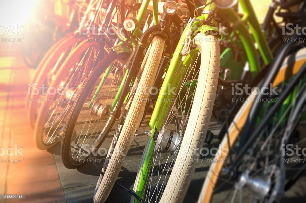 bicycle wheels in a row stock photo