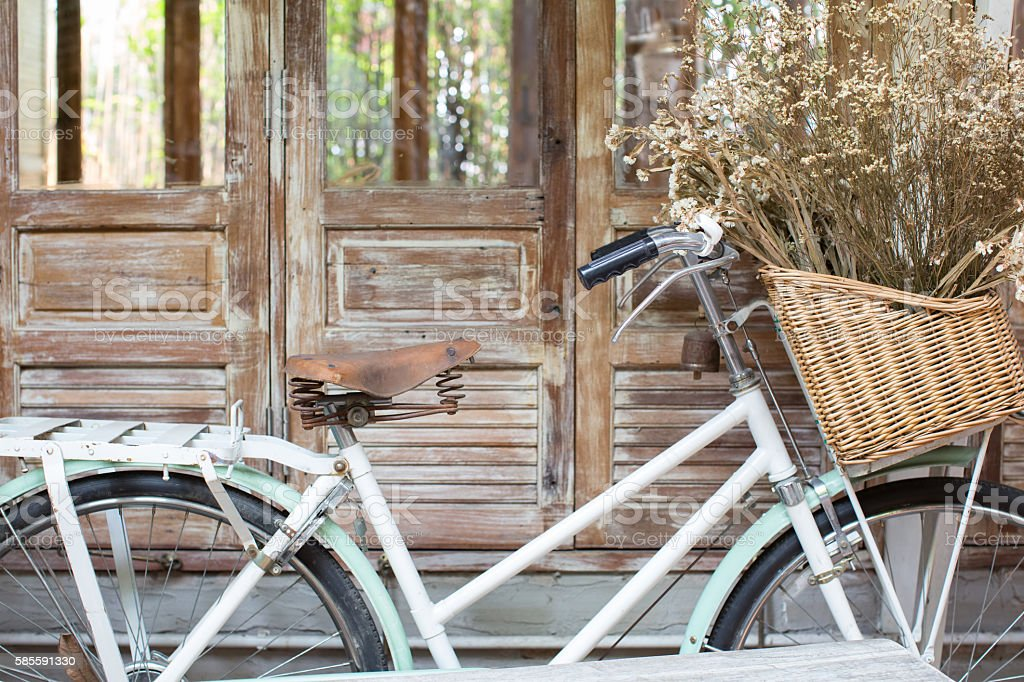 Bicycle with a basket of a dried bouquet stock photo