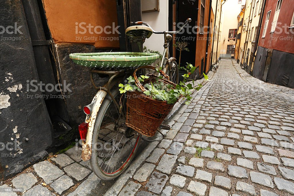 Bicycle with plants in old Gamla Stan royalty-free stock photo