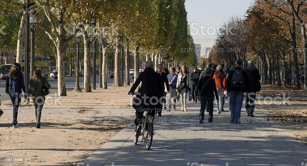 Bicycle woman on pavement royalty-free stock photo