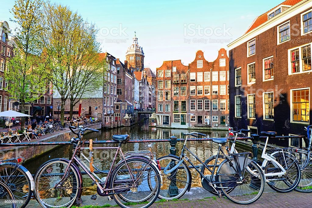 Bicycles along the canals of Amsterdam, Netherlands stock photo
