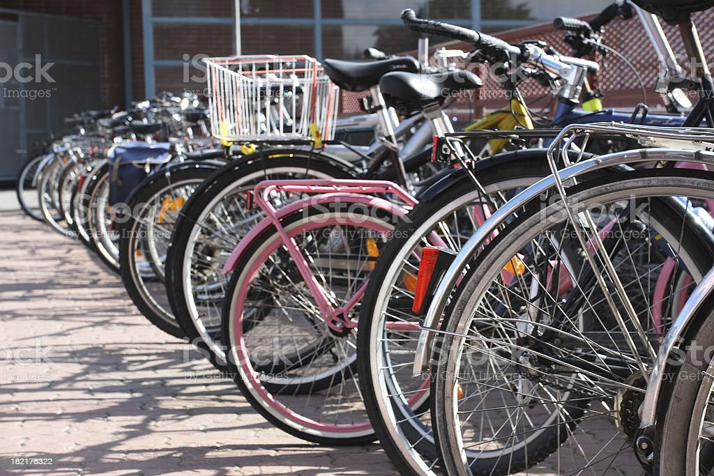 Bicycles at the parking lot near mall royalty-free stock photo