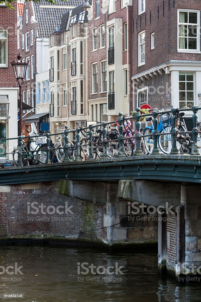 Bicycles attached to a bridge in Amsterdam stock photo