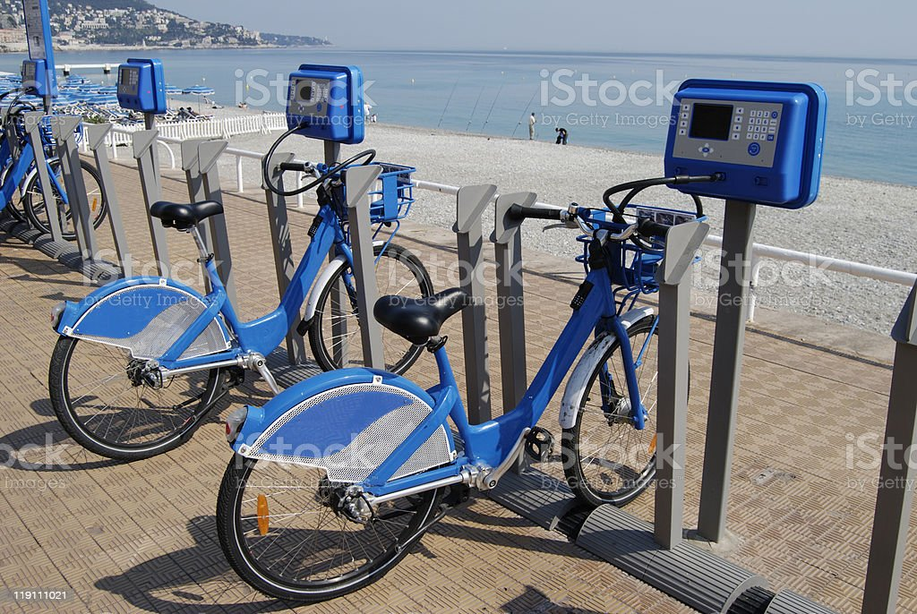 Bicycles for hire. Seafront. Nice. Cote d'Azur. France stock photo