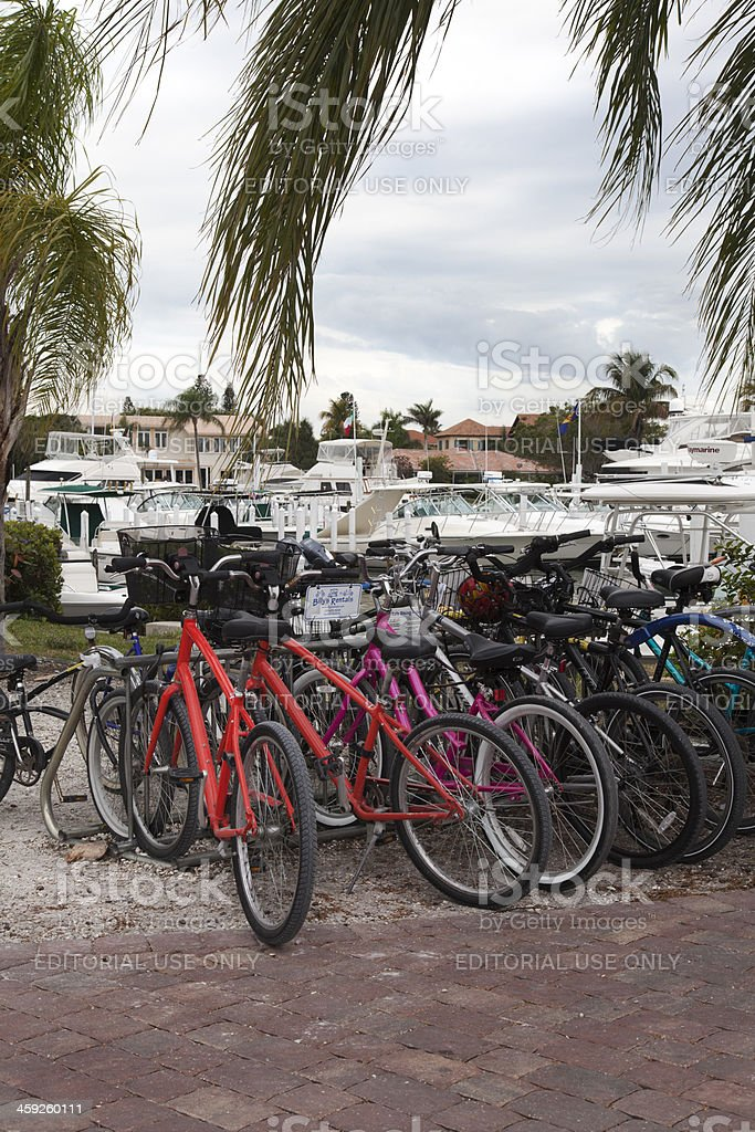 Bicycles for Rent and Yacht Sales stock photo