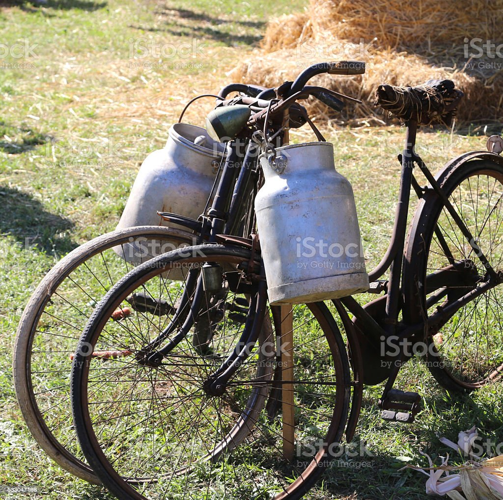 bicycles for the transport of milk in the bin stock photo