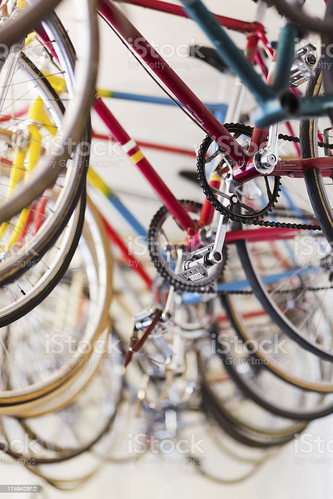 Bicycles hanging in a bike shop stock photo