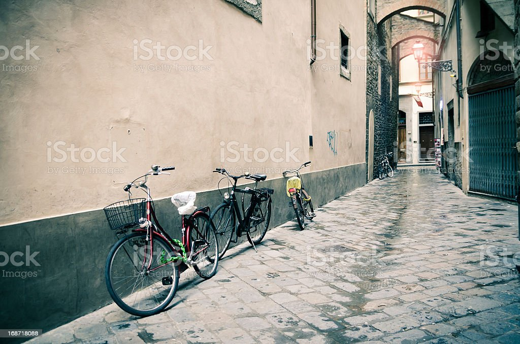 Bicycles in a Florence's alley royalty-free stock photo