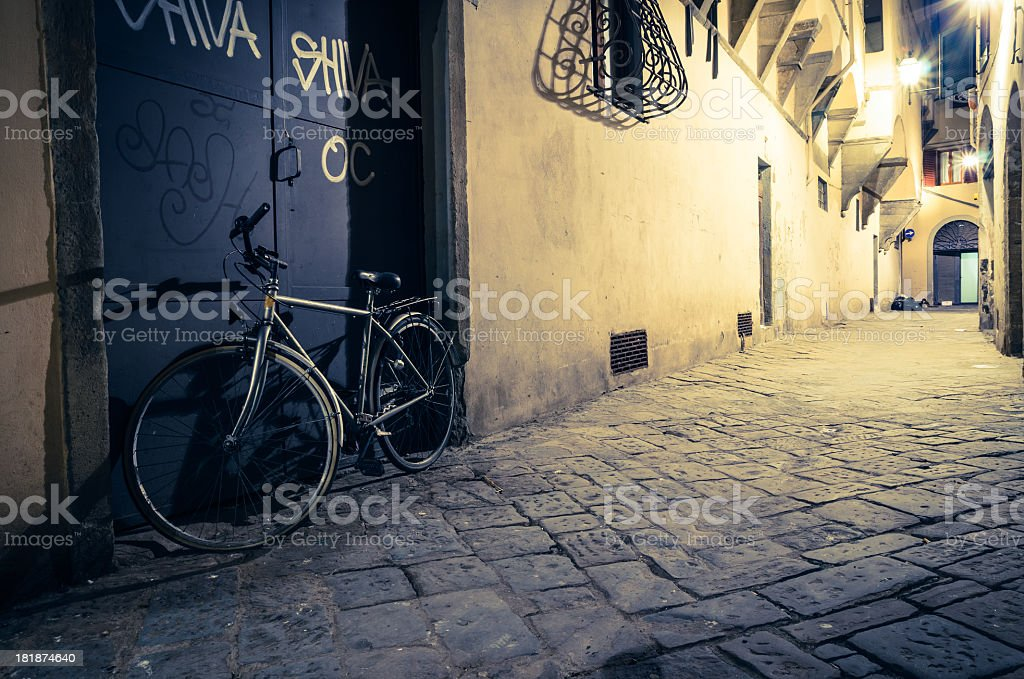 Bicycles in a mysterious alley, Florence, Italy royalty-free stock photo