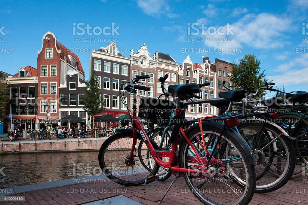 Bicycles in front of Prinsengracht canal in Amsterdam stock photo