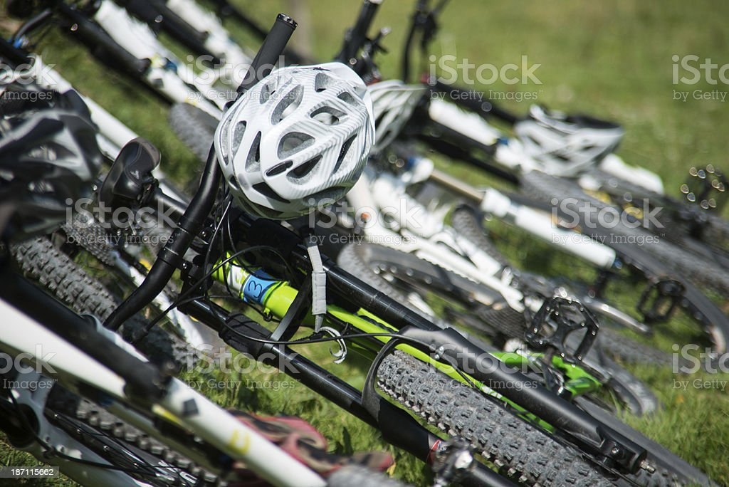 bicycles in meadow at a row stock photo