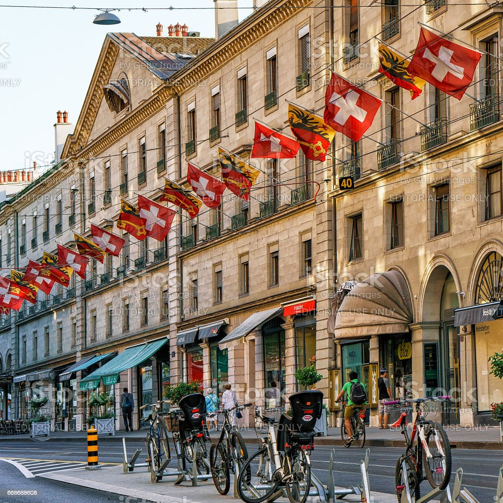 Bicycles in Rue Corraterie Street with flags in Geneva Switzerland stock photo