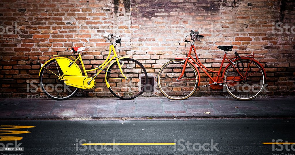 Bicycles Leaning Against Brick Wall City Street royalty-free stock photo