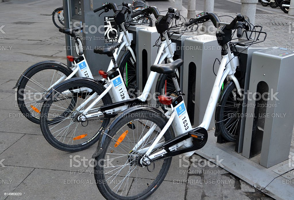 Bicycles of the BiciMAD service in Madrid stock photo