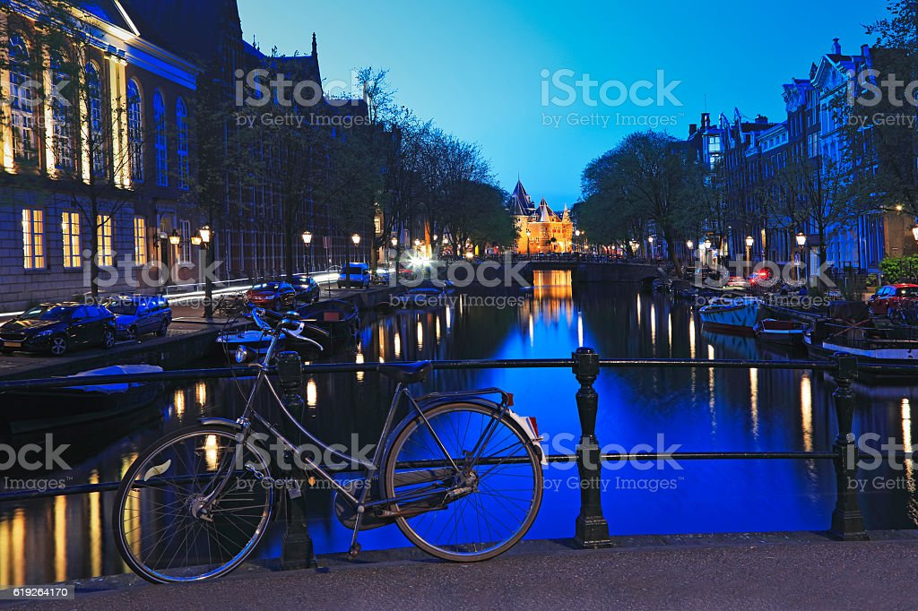 Bicycles on the bridge over an Amsterdam canal, Amsterdam, Netherlands stock photo
