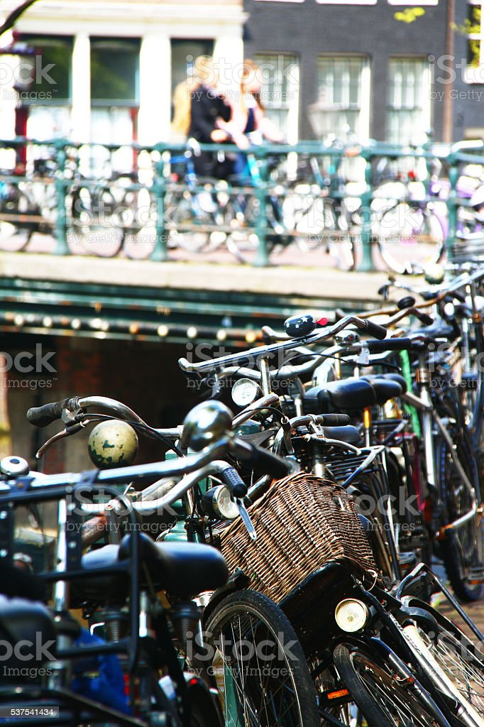 Bicycles park on footpath in Amsterdam, Netherlands stock photo