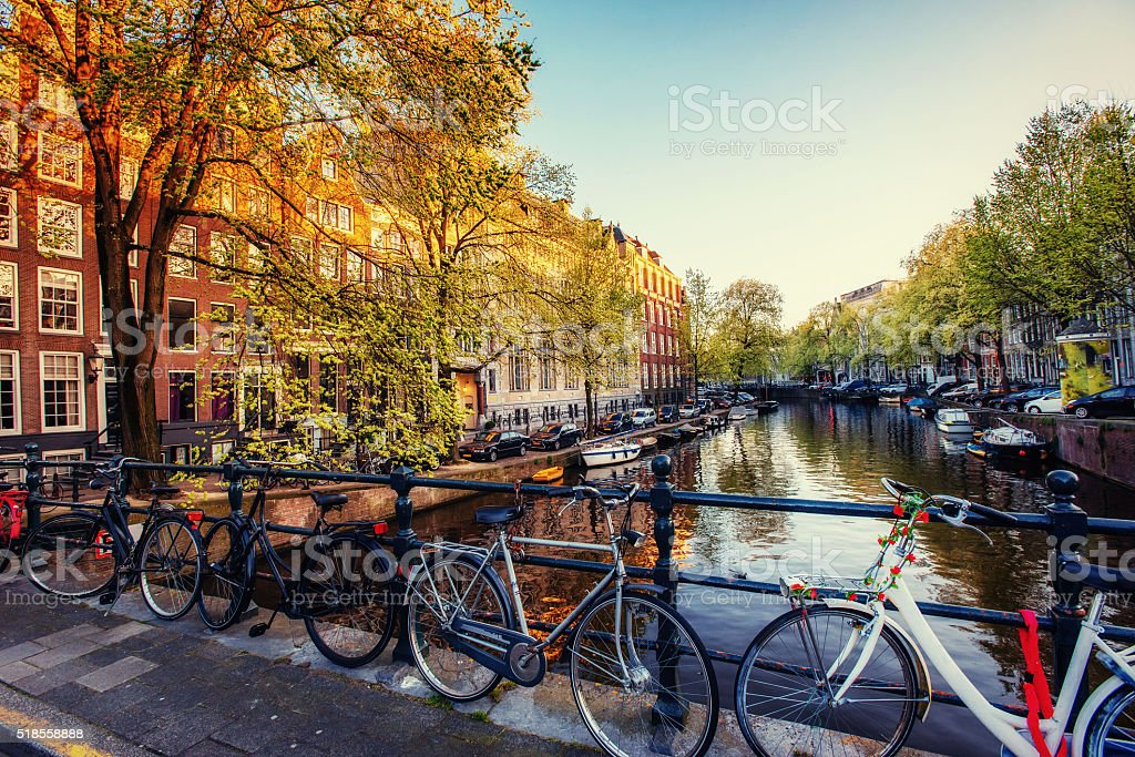 Bicycles Parked Along a Bridge Over the Canals of Amsterdam, stock photo
